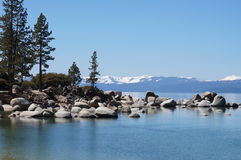 Lake Tahoe mountains and lake. Photo of beautiful Lake Tahoe located in Nevada & California in the United States. Beautiful water, trees and snow-capped Stock Images
