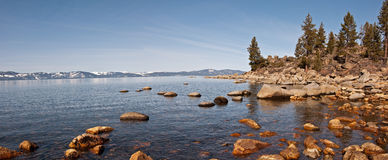 Lake Tahoe Panorama. A panoramic view of the California side of Lake Tahoe from the rocky Nevada shoreline Stock Photos