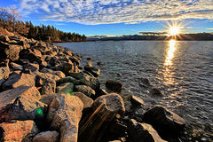 Lake Tahoe Sunset. Rocky Shoreline of Lake Tahoe at sunset, facing West from shore just South of Cave Rock on US Hwy 50 Royalty Free Stock Photography