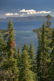 Lake Tahoe Through Trees. With mountains in background royalty free stock image