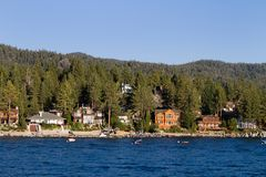 Lake Tahoe Waterfront Homes. Waterfront homes among the pine trees along the shoreline of Lake Tahoe, Nevada, USA Royalty Free Stock Photography