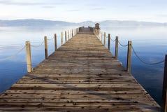 Lake tahoe in Winter. Lake tahoe wooden pier at sunset stock photo