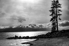 Lake Tahoe Winter Sunset B+W. Lake Tahoe, Nevada, USA - December 28, 2015: Lakeside views on the North Shore of Lake Tahoe, near Sand Harbor, and Incline Village royalty free stock photos