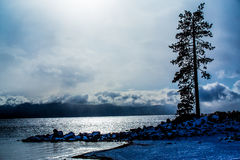 Lake Tahoe Winter Sunset. Lake Tahoe, Nevada, USA - December 28, 2015: Lakeside views on the North Shore of Lake Tahoe, near Sand Harbor, and Incline Village royalty free stock image