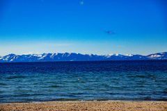 Lake Tahoe Winter Vista. Lake Tahoe, Nevada, USA - December 28, 2015: Lakeside views on the North Shore of Lake Tahoe, near Sand Harbor, and Incline Village royalty free stock photography