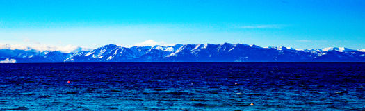 Lake Tahoe Winter Vista. Lake Tahoe, Nevada, USA - December 28, 2015: Lakeside views on the North Shore of Lake Tahoe, near Sand Harbor, and Incline Village royalty free stock photo