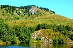 Lake 'Taul Mare' in  Rosia Montana, Apuseni Mountains, Transylvania. Rosia Montana is a commune of Alba County in the Apuseni Mountains of western Transylvania Royalty Free Stock Photography