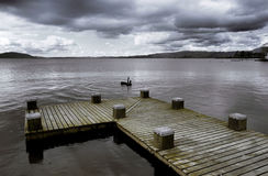 Lake Taupo. Pier into the still waters of Lake Taupo, New Zealand Stock Photography
