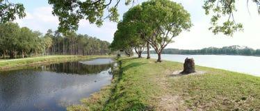 Lake Taylor, Largo, Florida. Panoramic view of Lake Taylor, Largo, Florida. Lake and canal, shore and trees stock photo