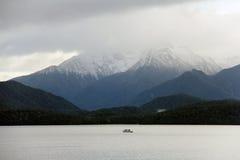 Lake Te Anau. A boat cruising across Lake Te Anau in winter Stock Photos