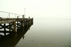 Lake Te Anau in heavy fog Royalty Free Stock Photos