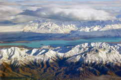 Lake Tekapo Aerial, New Zealand. Aerial landscape view of the colours of central Otago. The typical tan coloured hills in the foreground, the turquoise blue of royalty free stock image