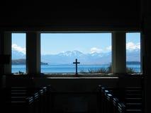 Lake Tekapo Church Window. Beautiful view of Lake Tekapo through the window of the Church of the Good Shepard in South Island New Zealand Royalty Free Stock Photo