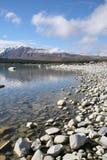 Lake Tekapo New Zealand. Rocky shore of Lake Tekapo New Zealand Stock Photos