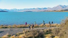 TOURISTS FLOCK TO PHOTOGRAPH THE MAJESTIC ALPS ACROSS LAKE TEKAPO, NEW ZEALAND stock images