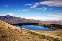 Lake Tekapo, New Zealand. Breathtaking blue Lake Tekapo. South Island, New Zealand Stock Images