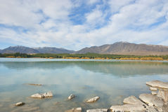 Lake with reflection of mountain range. Lake Tekapo with reflection of mountain range, South island of New Zealand Royalty Free Stock Image