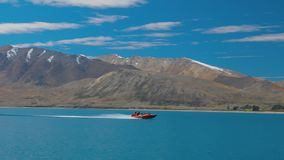Lake Tekapo with reflection of sky and mountains, New Zealand stock video footage
