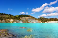 Lake then created from drowned coal mine. With hills with trees at far Royalty Free Stock Photography