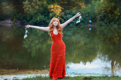 On the lake there is a girl. Royalty Free Stock Photography