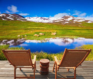 At the lake there are two deckchairs Royalty Free Stock Photography