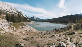 Lake with thousands of rocks all around panorama