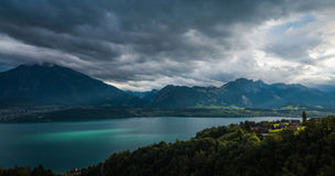 Lake Thun 2. Beautiful view on lake Thun with fantastic sun rays and reflection on water. Part of Swiss alps and green forest. City of Sigriswil, canton Bern Royalty Free Stock Image