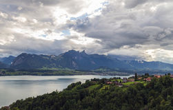 Lake Thun 7. Beautiful view on lake Thun with fantastic sun rays and reflection on water. Part of Swiss alps and green forest. City of Sigriswil, canton Bern Stock Images