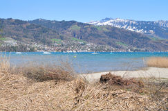 Lake Thun in early springtime. Sigriswiler Rothorn behind Lake Thun in early springtime royalty free stock image