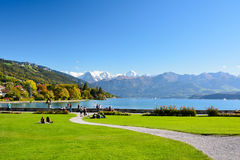 Lake Thun with Jungfrau mountain in autumn on clear blue sky , S Royalty Free Stock Images
