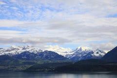 Lake of Thun and snowy mountains Royalty Free Stock Photo