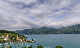 Lake Thun. View on small city, beautiful lake Thun, marine and many boats. City of Spiez, canton Bern, Switzerland Stock Image