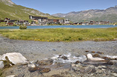 Lake of Tignes in France. Lake and river of village of Tignes le lac,  commune in the Tarentaise Valley, Savoie department in the Rhône-Alpes region in south Royalty Free Stock Photography