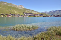 Lake of Tignes in France. Lake and village of Tignes le lac,  commune in the Tarentaise Valley, Savoie department in the Rhône-Alpes region in south-eastern Royalty Free Stock Images
