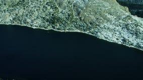 Lake tilt to mountain landscape stock video footage