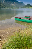 Lake in Tirol with wooden boats Royalty Free Stock Image