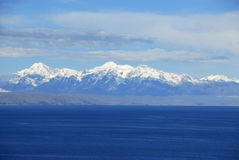 Lake Titicaca as seen from Isla del Sol. Lake Titicaca and part of Isla de la Luna with snow capped mountains in the background as seen from Isla del Sol Royalty Free Stock Image