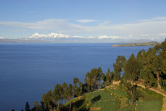 Lake Titicaca as seen from Isla del Sol. Lake Titicaca and Isla de la Luna with snow capped mountains in the background as seen from Isla del Sol Royalty Free Stock Photo