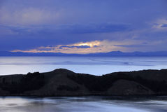 Lake Titicaca as seen from Isla del Sol. Lake Titicaca and part of Isla del Sol mountains in the background as seen from Isla del Sol Stock Photography