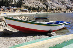 Lake Titicaca bay with fishing boat. Isla de Sol, Bolivia on Lake Titicaca in South America Royalty Free Stock Image