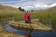 Lake Titicaca - Bolivia. Traditional Urus-Iruitos man and reed boat on Lake Titicaca in Bolivia (altitude 3809m 12497ft Stock Photo