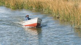 Man in a boat on the Titicaca lake in Bolivia. Lake Titicaca, Bolivia - September 2017: Man in a boat on the Titicaca lake in Bolivia Stock Photos