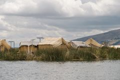 Lake Titicaca huts. Floating Uros islands landscape at lake Titicaca in Peru stock images