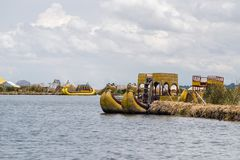 Lake Titicaca landscape. Floating Uros islands landscape by day on Titicaca lake royalty free stock images