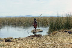 Lake Titicaca, Peru. Lake Titicaca with woman in totora boat in Peru Stock Photos
