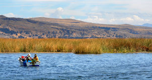 Lake Titicaca reed landscape with women stock image