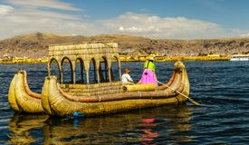 Lake Titicaca, Uros island, bamboo boat. The Uru or Uros  are an indigenous people of Peru and Bolivia. They live on forty-two self-fashioned floating islands in Stock Photo