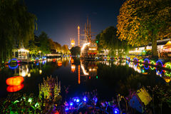The lake at Tivoli Gardens at night, in Copenhagen, Denmark. Stock Images