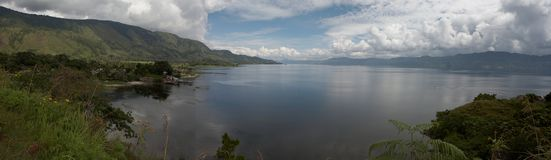 Lake Toba. Sumatra, Indonesia is the largest lake in South East Asia and was formed in the caldera of a gigantic volcano which erupted some 70,000 years ago Stock Photos
