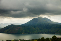Lake Toba Danau Toba and Pusubukit Volcano under heavy clouds royalty free stock images